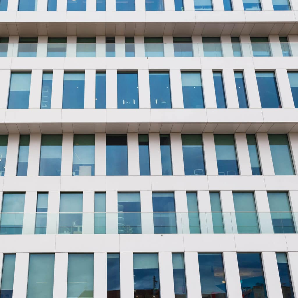 Modern Facade Of The Building Made Of Glass And Concrete